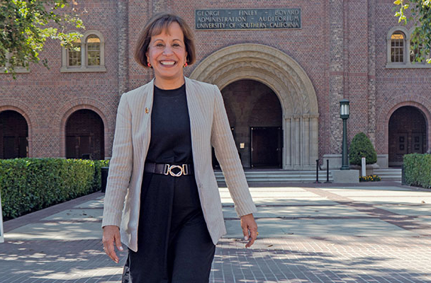 Dr. Folt in front of Bovard Administration building